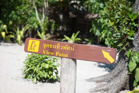 thai language: wood view point label with thai language for tourist people at on similan island Stock Photo