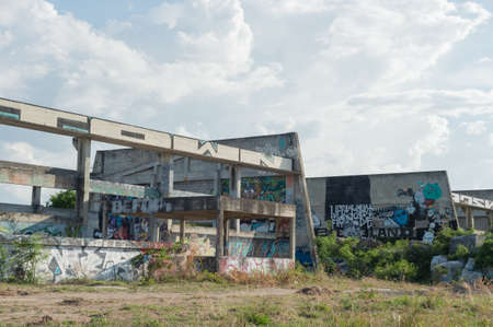 window graffiti: HUA HIN ,THAILAND - May30,2015 :Graffiti abandoned old factory structure.Main Street entrance to the town Editorial