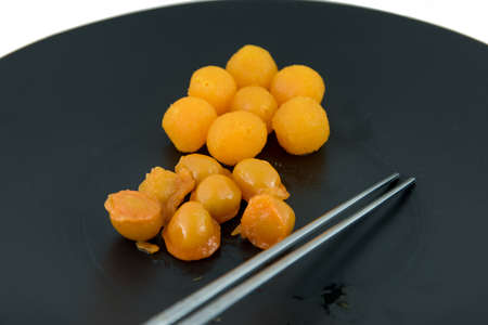 pinched: Gold egg yolks drops and Pinched gold egg yolks, ancient Thai Dessert Stock Photo