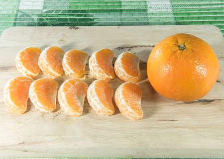 wooden block: Orange on wooden block Stock Photo