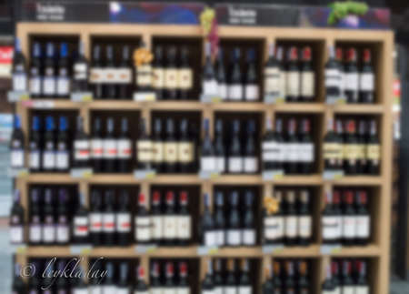 blurred background -the wine bottles at the wine shop