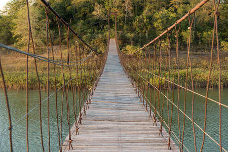 ambiguity: suspension bridge made of wood and sling.