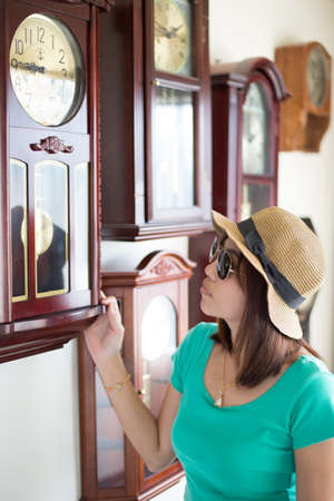 Women are viewing the beauty of the old clock.