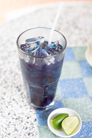 Blue pea or butterfly pea juice with lemon Stock Photo