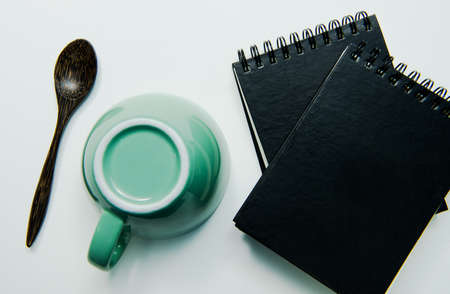 Note book and cup on white background , isolated