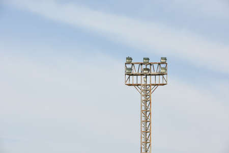 sportlights tower with blue sky background in stadium