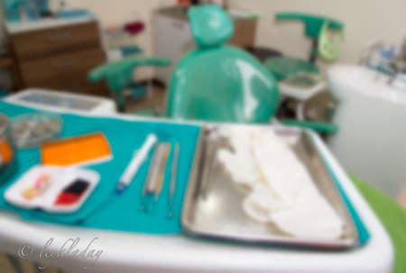Blurred abstract background of dental clinic interior space with dentist equipment, treatment seat