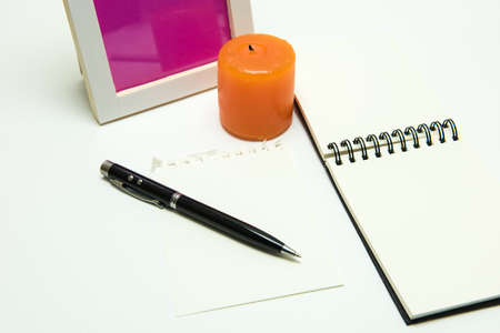 Pen on paper decorate note book , candle  on white background , isolated