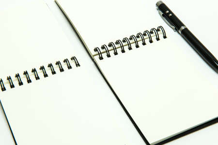 Note book,pen on white background , isolated