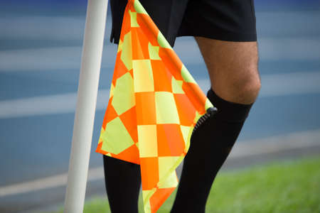 Assistant referee hold flag