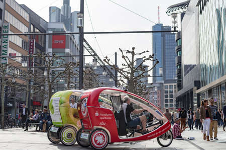 Bike taxis in Frankfurt city: sustainability and modern city life. Frankfurt am Main, Germany - April 1 2014 Editorial
