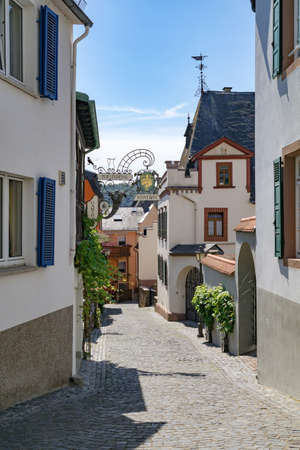 Perspective of a traditional alleyway in small winemaking town of Southern Germany Rudesheim am Rhein . Rudesheim am Rhein, Germany - September 1 2015