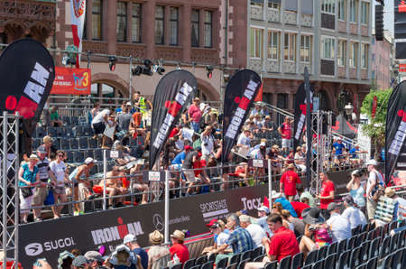 yearly: Sport fans waiting for the triathletes on the tribunes to encourage them during the yearly Mainova Ironman European Championship (triathlon). Frankfurt am Main, Germany - July 5 2015