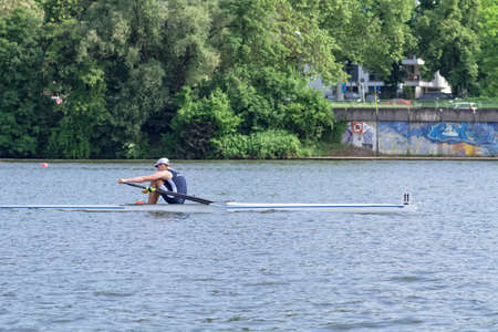 A single scull rowing competitor on the Neckar river at the boat racing Heidelberg Regatta 2018. Heidelberg, Germany - May 12 2018.