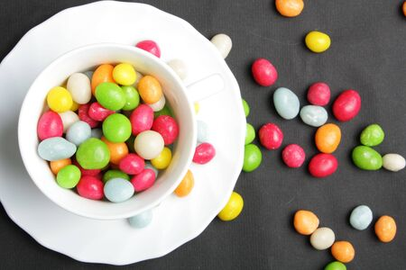 colored candy on black Stock Photo - 6117456