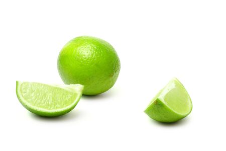 Slice and lime on white background (isolated) Stock Photo