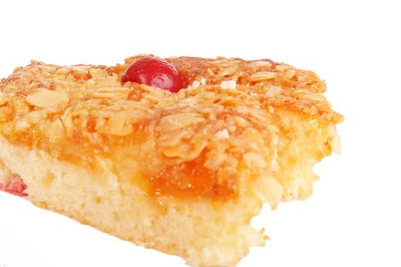 biscuit cake with fruit jam and cherry photo
