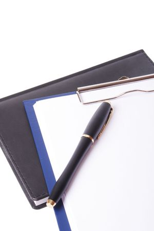 pen paper and notepad on white background photo