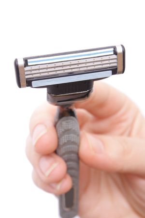 shaver in hand on white background (close up) Stock Photo - 6586410
