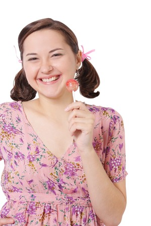 Young beautiful girl on white background with Lollipop (isolated) photo