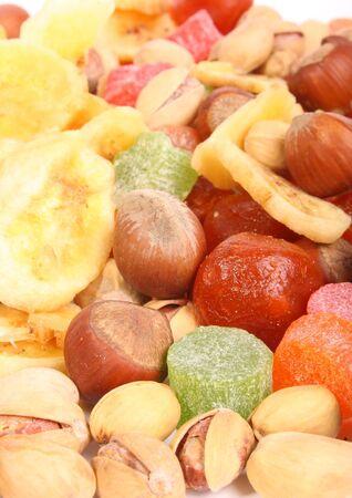 Kumquat, pineapple, pistachios, hazelnut and bananas on white background (isolated, ) photo