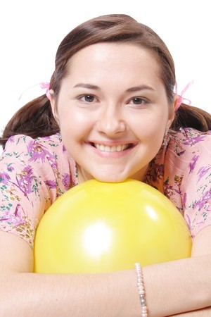 Young beautiful girl on white background with balloons (isolated) photo