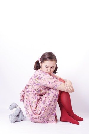 Young beautiful girl on white background with Teddy Bear (isolated) photo