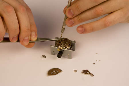 disjoint: Inside of a watch. Repair. Focus on watch parts. Stock Photo