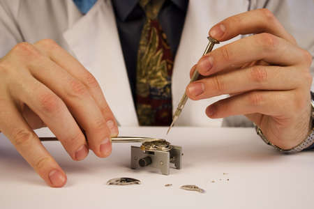 watchmaker: Inside of a watch. Repair. Focus on watch parts. Stock Photo