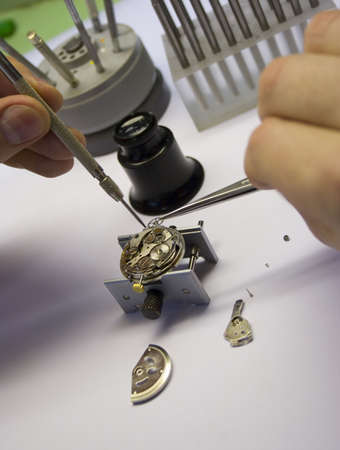 Inside of a watch. Repair. Focus on watch parts. photo
