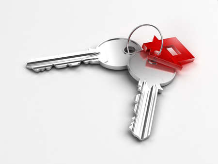 Macro view of two silver keys with red house figure on the white background photo