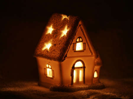 immovable property: Macro photo of small candle winter house