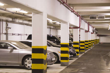 car parking: Underground parking in apartment house in Moscow Editorial