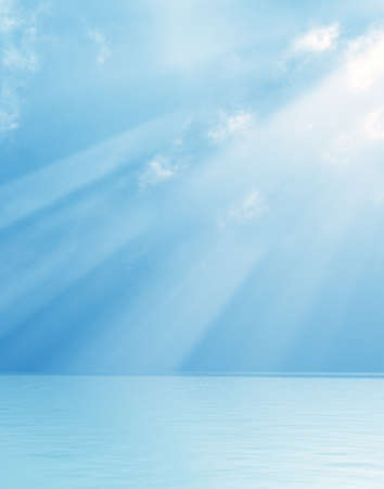 clouds scape: Wonderful god rays over the sea Stock Photo
