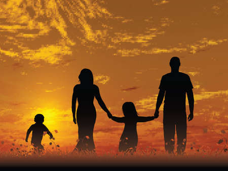 A young family outdoors enjoying the sunset
