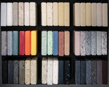 Sample of artificial acrylic stone for kitchen countertops and other furniture. Stone texture for modern interior design