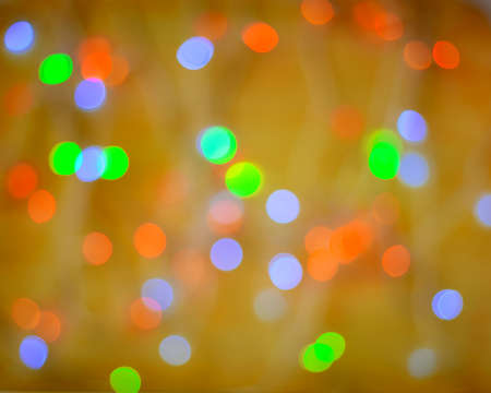 Multi-colored abstract blurred shiny background. Bright confetti glitter. Festive Christmas glowing background