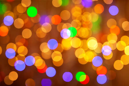 Golden lights holiday background. Abstract, bright multicolored background, blurry bokeh