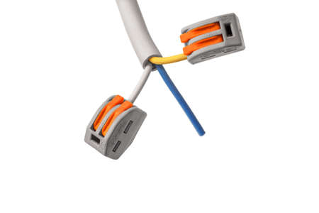 Screwless wire connectors, self-locking terminals on a white insulated background. During electrical installation, it is often necessary to connect several wires together at once. In this case