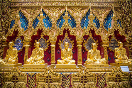 Famous Monk statues are located inside a beautiful temple  Editorial