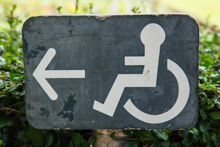 wheelchair sign showing the way for the people who use wheelchair  Stock Photo