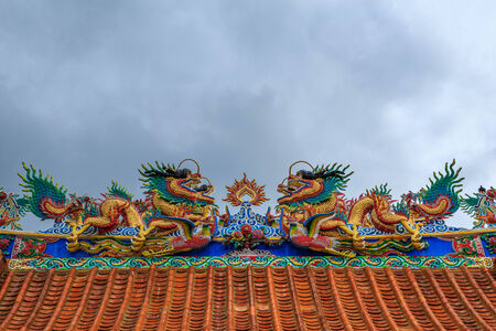 The two dragons on top of the roof of a Chinese temple  Stock Photo