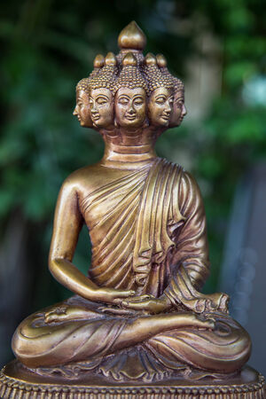 Meditation buddha statue has many heads.