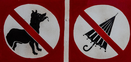No dog and umbrella signs are shown at a museum.