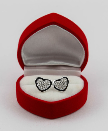 Heart earrings made of silver in a red case. Stock Photo