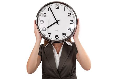 ifestyle: Woman holding a wall clock in front of her face ,isolated on white
