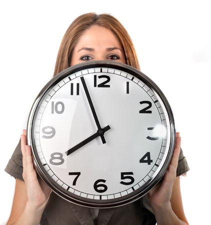 Woman holding a wall clock under her eyes,isolated on white photo