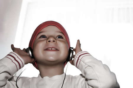 Young girl listening to music on headphone photo