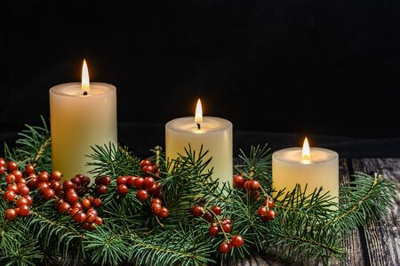 Christmas candles on black background