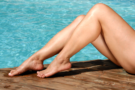 knees bent: Bare Legs by the Pool